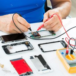 stock-photo-close-up-of-man-repairing-cellphone-with-multimeter-244875616